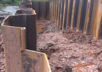 Sheet piling in place for the channel