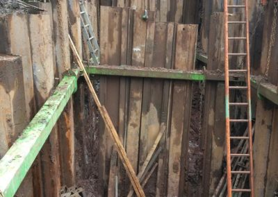 Pictures at bottom end of Screw Channel incl. removal of temporary sheets between base and outfall;
